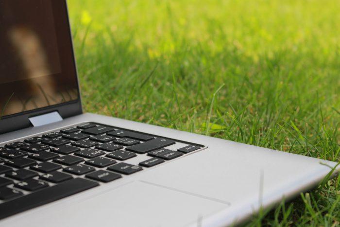 Open Laptop On A Grassy Field
